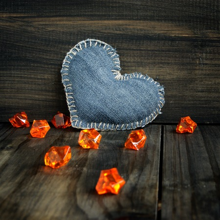 Jeans heart on wooden background Valentines Day photo