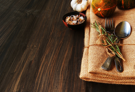 Seasonal wooden table setting with small pumpkins photo