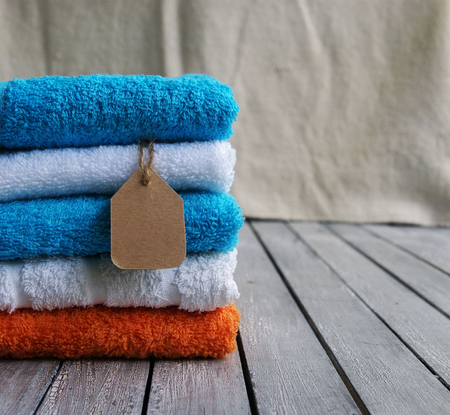 stack of towels with a price tag close up Stock Photo