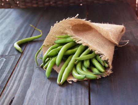 linen bag: green beans in a linen bag on a wooden surface