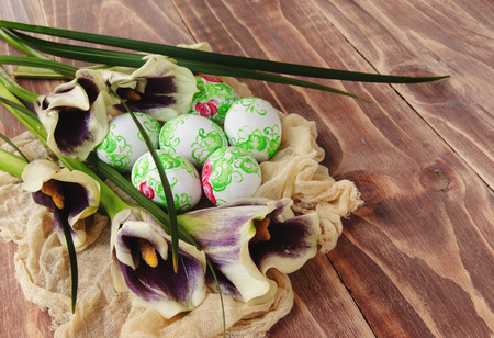 Easter eggs painted with flowers on a wooden surface photo