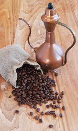 linen bag: linen bag with coffee beans, a spoon and oriental teapot and cinnamon Stock Photo