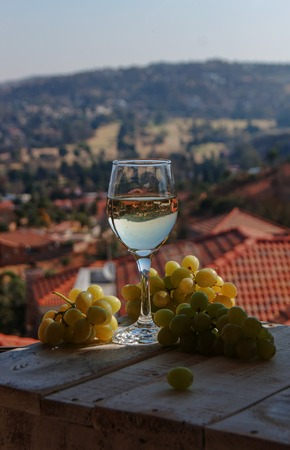 karavanke: glass of wine on a background of mountains with cheese and grapes
