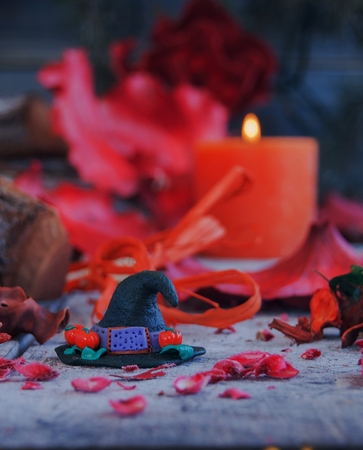 stage makeup: witch hat  with Halloween Pumpkins, red, rustic Stock Photo