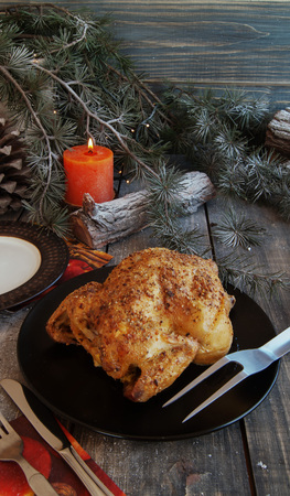 baked chicken: Baked chicken for Christmas on wodwn table Stock Photo