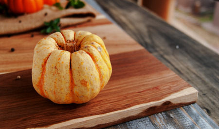 peaceful background: pumpkin on a wooden table, selective focus