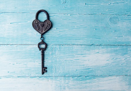door lock love: a Heart and key on wooden background
