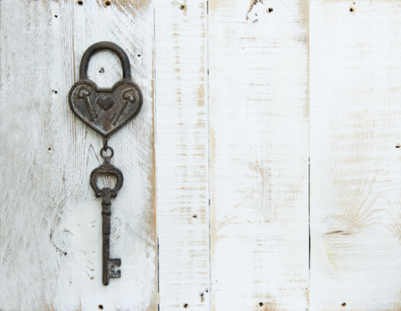 a Heart and key on wooden background