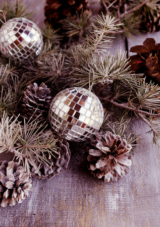 christmas tree ball: Christmas card with fir branches, tangerines, pine cones, and decoration elements , selective focus