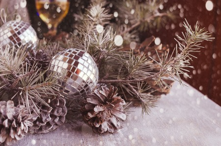 christmas tree ball: Christmas card decoration with fir branches, tangerines, pine cones, and decoration elements , selective focus