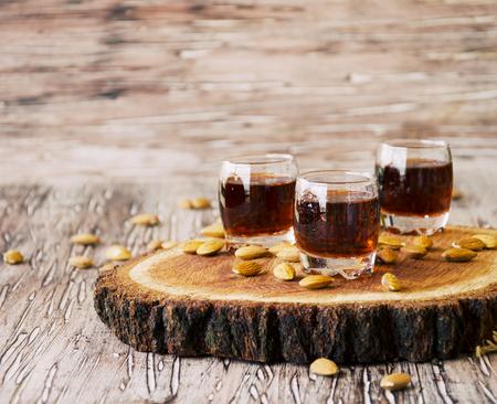 amaretto: Italian liqueur Amaretto in cups, selective focus Stock Photo