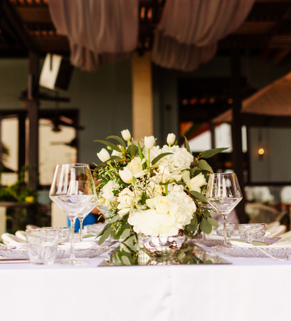 Set table for a white and aqua blue beach wedding dinner decorated selective fokus