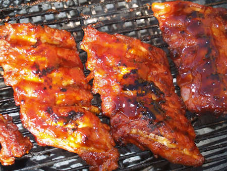tangy: BBQ ribs on griddle   Stock Photo