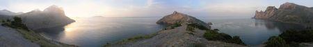 sunrise sea panoram with sun reflection and mist (Novyj Svit reserve, Krimea, Ukraine) Stock Photo - 569664