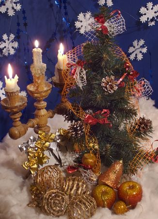 Christmas - New Year composition with wicker toy balls, Christmas tree toys, candle, clock (vertical)