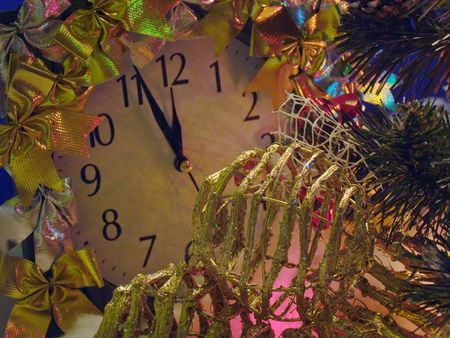 Christmas - New Year composition with adorn clock and wicker Christmas tree toys  Stock Photo