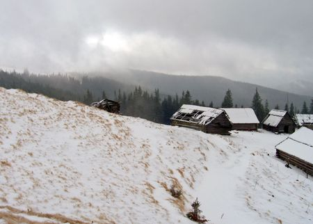 mountain live farming settlement in winter wind and overcast cloudy weather photo