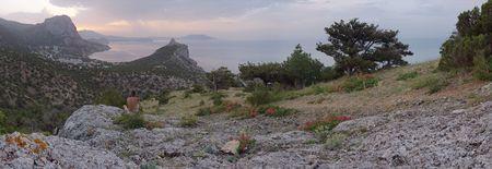 rocky mountain juniper: Morning coastline landscape of Novyj Svit reserve (Crimea, Ukraine) with man, who contemplate it. Original of this composite picture have 96 megapixel.