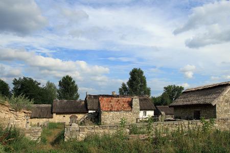 Small historical farmstead with stone buildings (preceding century, museum of Ukrainian folk architecture in Pirogovo village (near Kiev)) photo