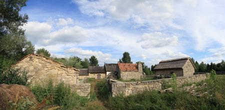 Old historical farmstead with stone buildings (Ukraine, preceding century). Five shots composite picture. photo