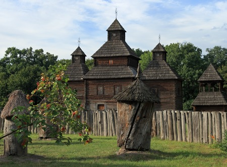 Ukrainian historical country wood church (log beehive and viburnum branch in front) photo