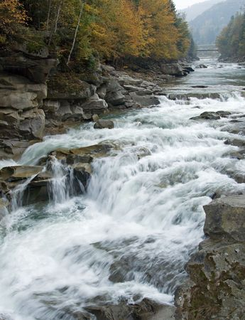 Autumn mountain river view with some waterfalls photo