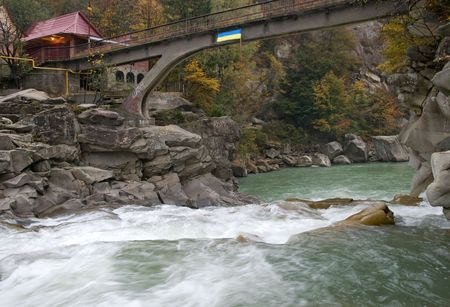 Autumn mountain river view (with waterfall and bridge) photo