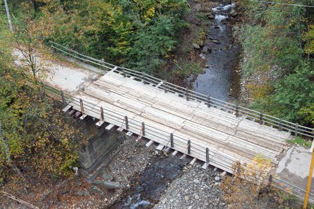 Bridge across mountain river (view from above) photo