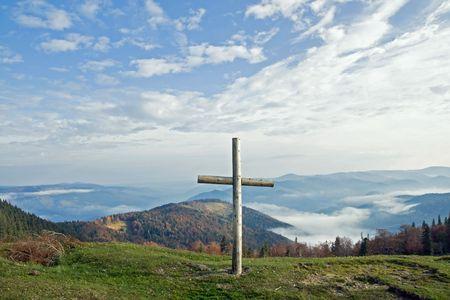 Cross on fall mountain plateau