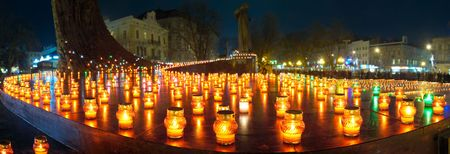 Sorrowful candles on Freedom Square  of Lvov-City (24.11.2007) in Commemoration of 1932-33y. mass hunger in Ukraine. All people faces unrecognizable photo