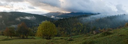 Misty daybreak in autumn Carpathian mountain, Ukraine. Eight shots stitch image. Stock Photo - 2558191
