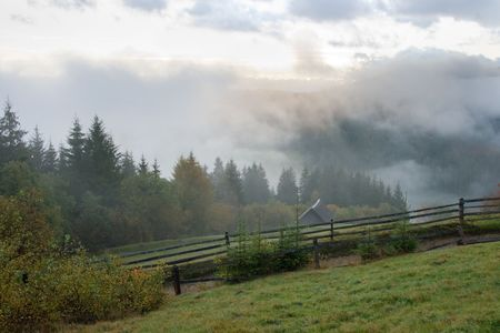 Misty early daybreak in autumn Carpathian mountain, Ukraine. Stock Photo - 2715113