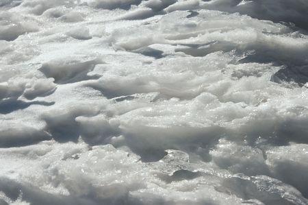mountainside: Wind form ice texture on winter mountain snow surface