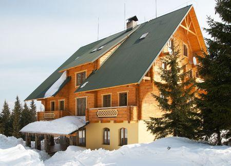 mountainside: Wonderful wood house on picturesque winter mountainside resort place (Ukraine, Carpathian Mts)
