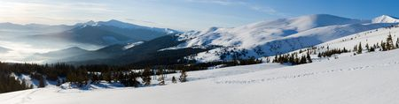 Mountain morning panorama with haze in contra light direction (Drahobrat Ski Resort, Yasenja village, Zacarpatsjka Region, Carpathian Mts, Ukraine). Thirty shots stitch image. photo