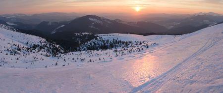 Mountain sunrise panorama in pink tones with sun way (Drahobrat Ski Resort, Yasenja village, Zacarpatsjka Region, Carpathian Mts, Ukraine). Seven shots stitch image. photo