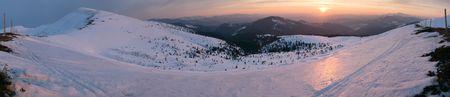 Mountain sunrise panorama in pink tones with sun way (Drahobrat Ski Resort, Yasenja villadge, Zacarpatsjka Region, Carpathian Mts, Ukraine). Twelve shots stitch image. photo