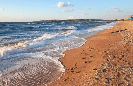 great bay: Sea surf wave and sandy beach with footprints Stock Photo