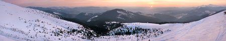 Mountain sunrise panorama (Drahobrat Ski Resort, Yasenja villadge, Zacarpatsjka Region, Carpathian Mts, Ukraine). Twelve shots stitch image. photo