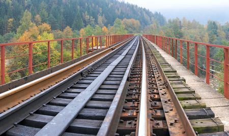 Railway on bridge across mountain river. Autumn, four shots composite picture. Stock Photo - 3527236