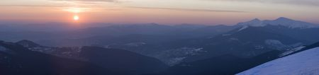 Mountain sunrise panorama (Drahobrat Ski Resort, Yasenja village, Zacarpatsjka Region, Carpathian Mts, Ukraine). Seven shots stitch image. photo