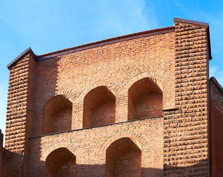 restoring: Restoring fragment of ancient brick watchtower on Lviv City wall  ( Ukraine). Eight shots composite picture.