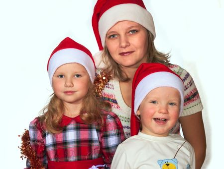 Happy mother with small boy and girl before the Christmas (on light background - not isolated) photo
