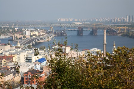 far off: Kyiv (Ukraine) northeast direction panorama from territory of Saint Andrews Church. New bridge building and Trojeschyna dwelling Locality far off