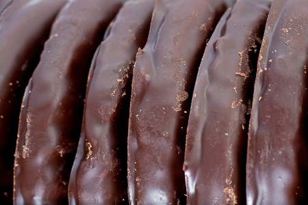 sweetness: appetizing biscuit in dark chocolate food background