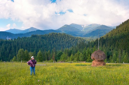 mountainside: Summer mountain blossoming green meadow with haystack (Carpathian Mt-s, Ukraine). Stock Photo