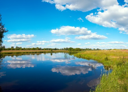 rushy: Summer rushy lake panorama view with clouds reflections. Three shots composite picture.