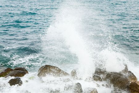 stony: Stony sea coastline  and wave with splashes