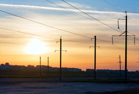 tangent: Sunset sky above the town and high-tension transmission line