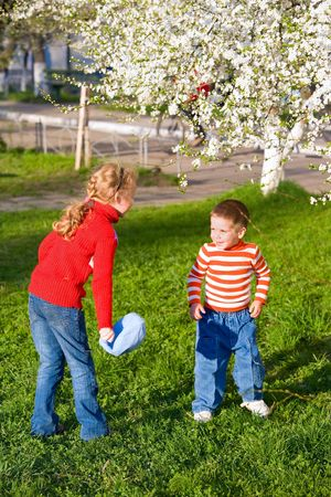 pranks: Happy small children in spring recreation ground Stock Photo